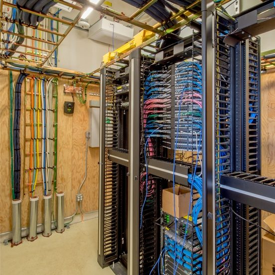 Data room with servers and telephone connections.